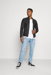 Tigha - CADAN - Leather jacket - black stone wash - 1