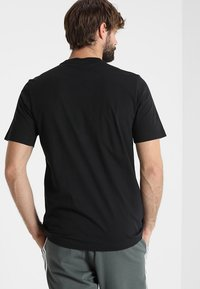 adidas Performance - LIN TEE - T-Shirt print - black/white - 2