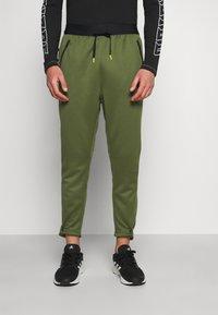 adidas Performance - TECH PANT - Tracksuit bottoms - wild pine - 0