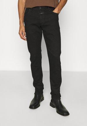 UNITY - Straight leg jeans - black