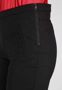 YAS Tall - YASPEYTON ECCO - Trousers - black - 3