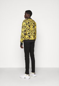 Versace Jeans Couture - LOGO BAROQUE  - Sweatshirt - black - 2