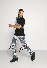 Sixth June - CAMO STRAP PANTS - Cargo trousers - blue - 1