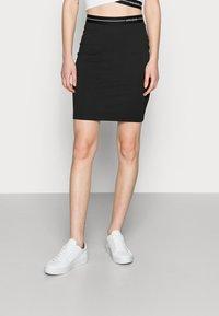 Calvin Klein Jeans - MILANO LOGO ELASTIC SKIRT - Mini skirt - black - 0