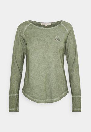 NIKARA - Long sleeved top - tilleul