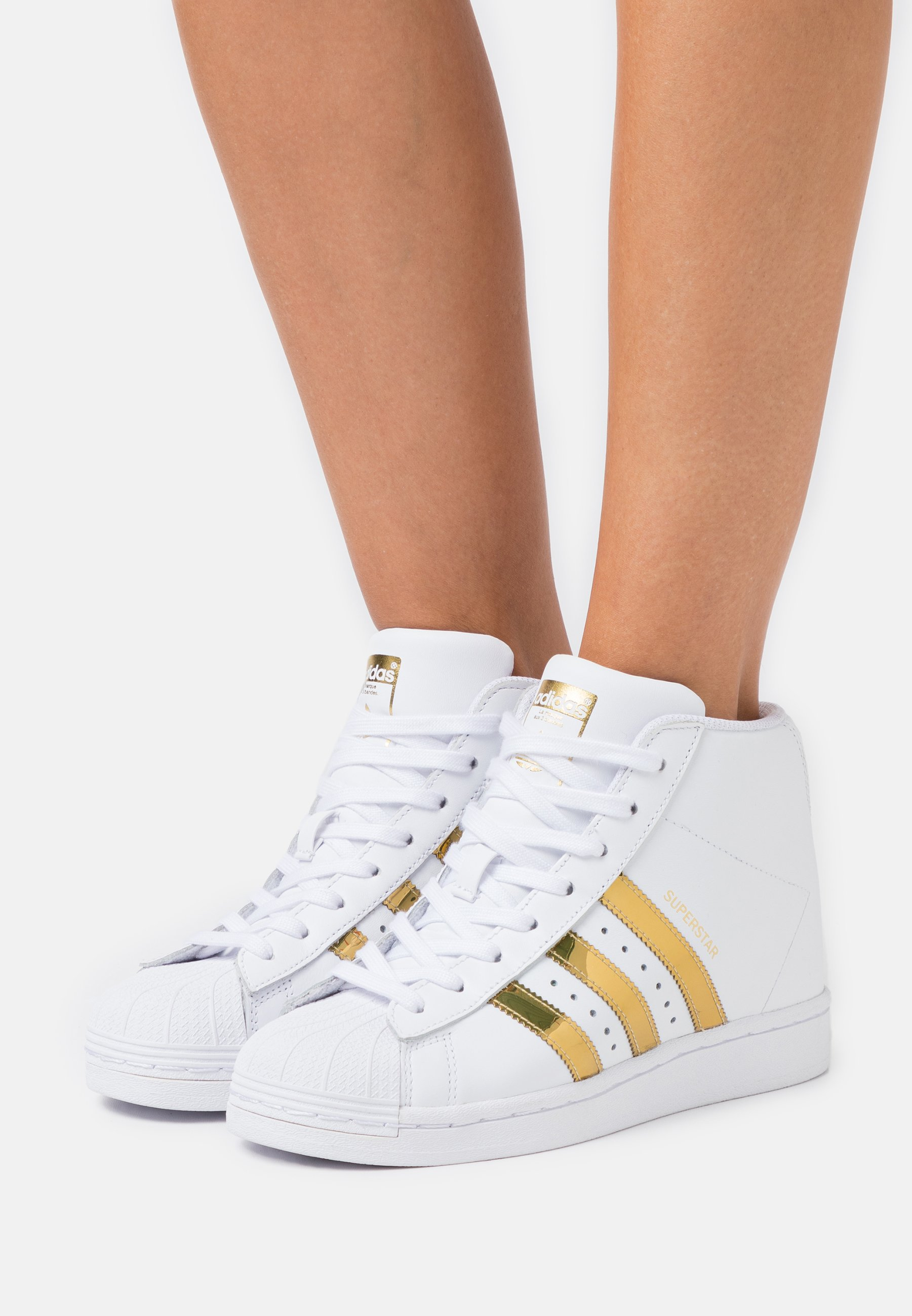 ayuda Gobernar aplausos  adidas Originals SUPERSTAR UP - High-top trainers - footwear white/gold  metallic/core black/white - Zalando.ie