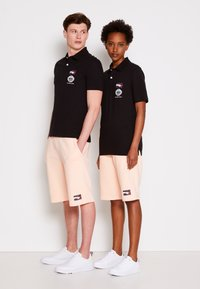 Tommy Hilfiger - ONE PLANET SMALL LOGO UNISEX - Polo shirt - black - 3