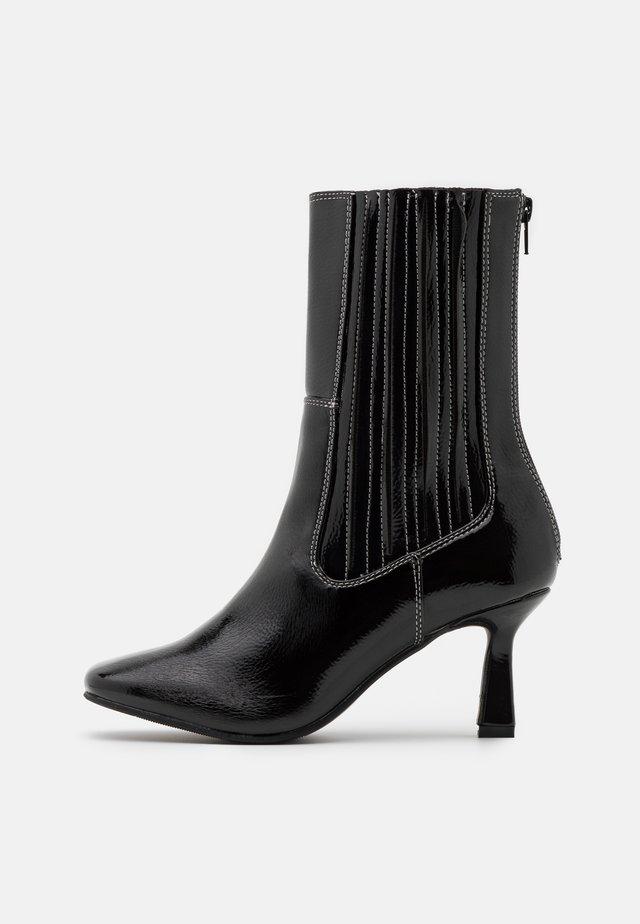 ROWE - Kotníkové boty - black