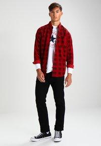 Wrangler - GREENSBORO - Straight leg jeans - black - 1