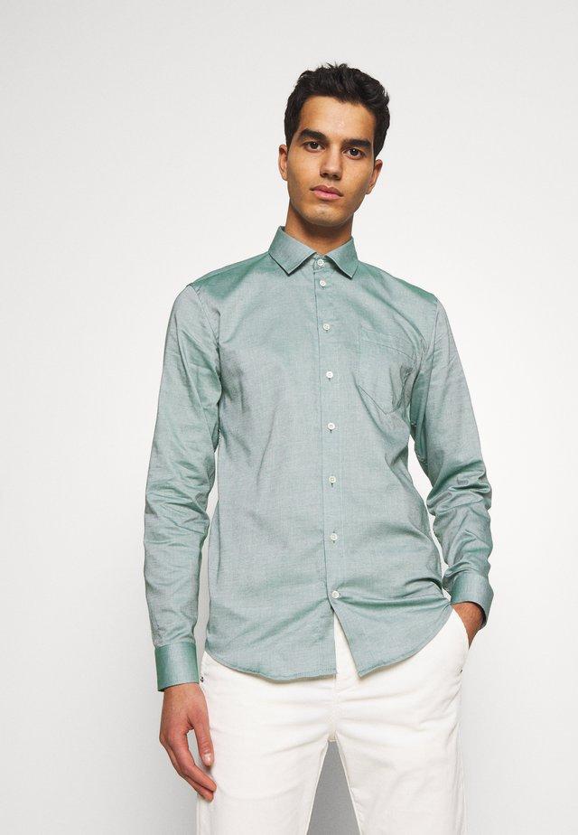 ANTON CLAUS - Shirt - green