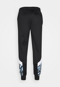 Puma - MANCHESTER CITY ICONIC GRAPHIC TRACK PANTS - Tracksuit bottoms - black/spectra yellow - 1