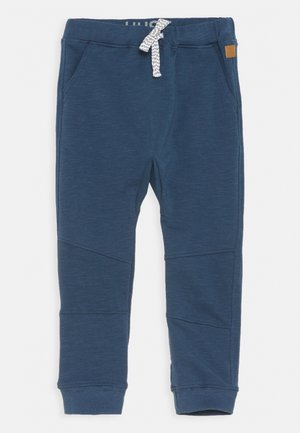 GEORG  - Tracksuit bottoms - blue