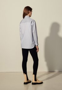 sandro - MADDLY - Button-down blouse - marine/ecru - 2