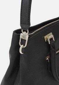 Guess - HANDBAG DESTINY SOCIETY CARRYALL - Handbag - black - 3