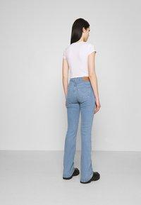 Levi's® - 725 HIGH RISE BOOTCUT - Bootcut jeans - light-blue denim - 2