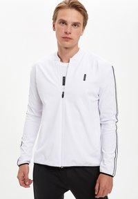 DeFacto Fit - Zip-up hoodie - white - 1