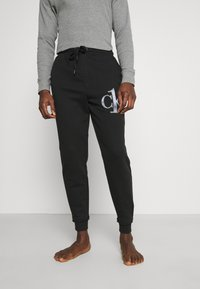 Calvin Klein Underwear - ONE RAW JOGGER - Pyjama bottoms - black - 0