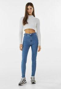 Bershka - SUPER HIGH WAIST - Slim fit jeans - blue denim - 1