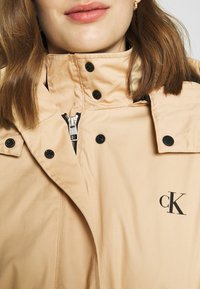 Calvin Klein Jeans - LONG UTILITY HOODED  - Winter coat - irish cream - 7