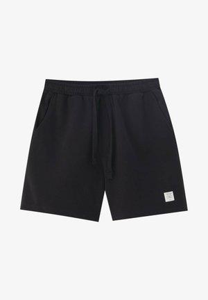 KOMFORT FIT - Shorts - black