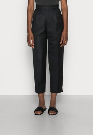 ALTA TROUSERS - Trousers - black