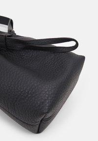 Furla - GIOVE MINI DRAWSTRING UNISEX - Across body bag - nero - 5