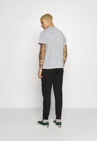 STAPLE PIGEON - UNISEX - Tracksuit bottoms - black - 2