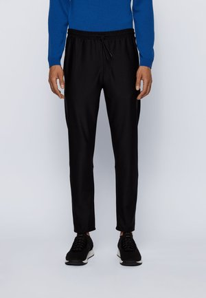 HICON - Tracksuit bottoms - black