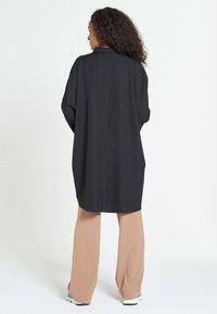 Jascha Stockholm - MAROCAIN - Robe chemise - black - 2