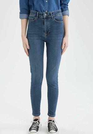 SUPER SKINNY  - Slim fit jeans - blue