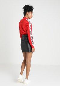 Vero Moda - VMYOURS BUTTER SHORT SKIRT - Mini skirts  - black - 2