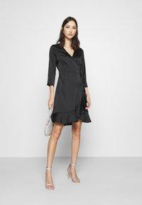 Vero Moda - VMHENNA WRAP DRESS - Cocktail dress / Party dress - black - 1