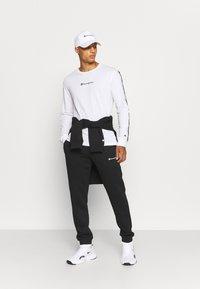 Champion - CUFF PANTS - Tracksuit bottoms - black - 1