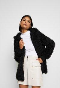 ONLY - ONLMELANIE HOOD JACKET - Winter coat - black - 0