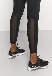 Nike Performance - Legginsy - black/magic ember/white - 4