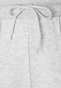 NA-KD - SEAM DETAIL  - Tracksuit bottoms - grey melange - 5