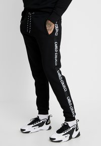 Carlo Colucci - Tracksuit bottoms - schwarz - 0