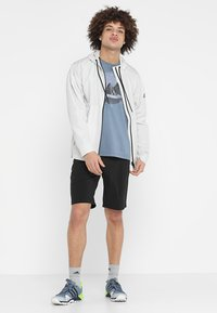 adidas Performance - URBAN - Cortaviento - raw white - 1
