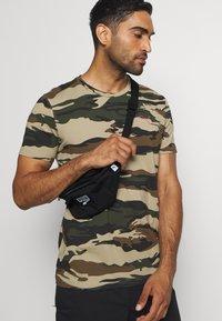 Puma - DECK WAIST BAG - Bum bag - black - 0