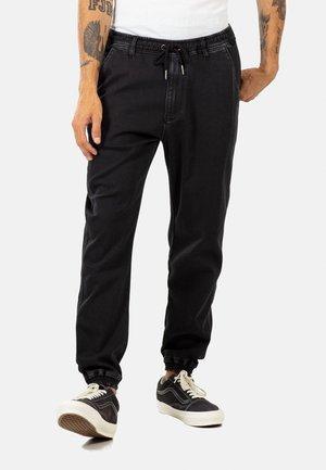 REFLEX - Trousers - black weave