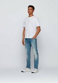 BOSS - TLOVE  - Print T-shirt - natural - 1