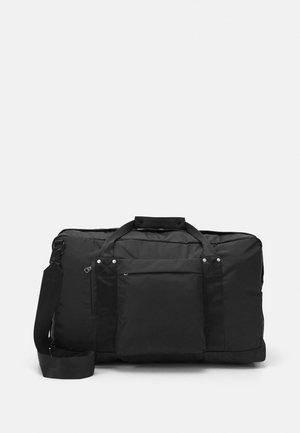 WEEKEND BAG UNISEX - Weekend bag - black