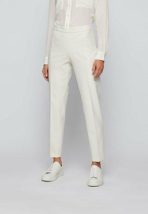 TILUNA_SIDEZIP - Trousers - natural