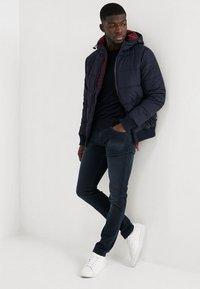 Replay - HYPERFLEX + ANBASS - Slim fit jeans - blue/black denim - 1