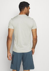 adidas Performance - AEROREADY TRAINING SPORTS SHORT SLEEVE TEE - Print T-shirt - grey