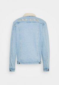 Karl Kani - TRUCKER JACKET UNISEX - Denim jacket - light blue - 1