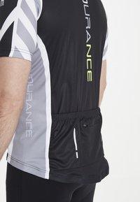 Endurance - RADTRIKOT PARMER M CYCLING - Print T-shirt - black - 6