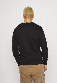 STAPLE PIGEON - LOGO CREWNECK UNISEX  - Sweatshirt - black - 2