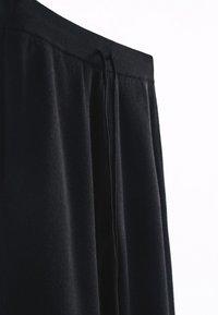 Massimo Dutti - Tracksuit bottoms - black - 6