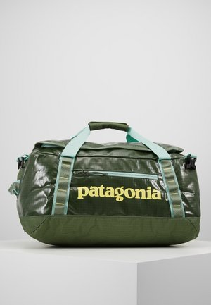 BLACK HOLE DUFFEL 40L - Sportstasker - camp green